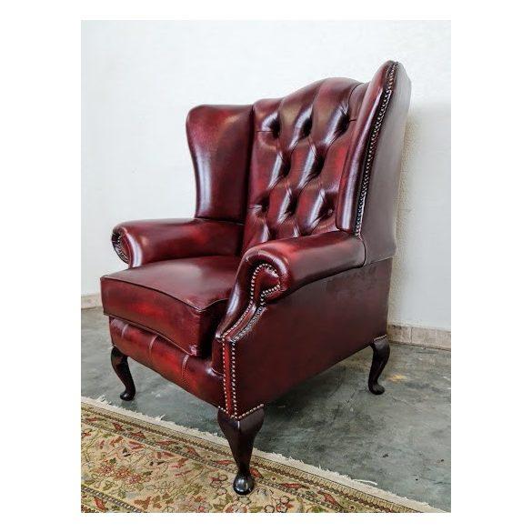 Chesterfield antik burgundi színű füles bőr fotel